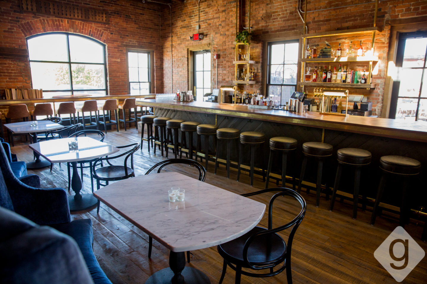 Geists Interior Is Divided Into Three Sections Including A Bar And Two Separate Dining Areas Throughout Thee Exposed Brick And Ceilings Are